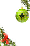 Christmas border with green bauble. Christmas festive border with handpainted Irish green bauble, lucky shamrock, pine tree branch and red ribbons. Isolated over Royalty Free Stock Image