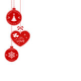 Christmas border with hanging Christmas ornaments. Hanging Christmas balls and heart with the writing Merry Christmas and Happy New Year and The Gift of Love for Royalty Free Stock Photography
