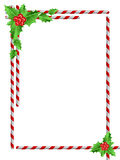 Christmas border. With holly leaves & berries Royalty Free Stock Photo