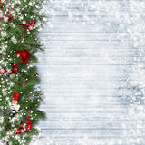 Christmas border with holly and nutcracker on vintage wood. Royalty Free Stock Photography