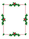 Christmas border with holy leaves. And candy sticks Stock Image