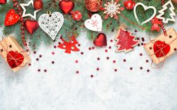 Christmas border isolated, composed of fresh fir branches and ornaments in red and white royalty free stock photos