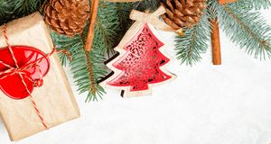 Christmas border isolated, composed of fresh fir branches and ornaments in red. Wide arch shaped Christmas border isolated on white, composed of fresh fir royalty free stock photography