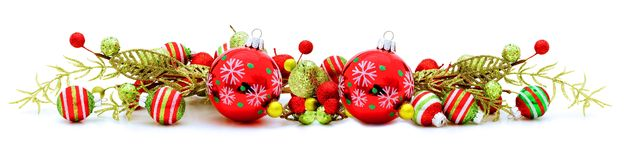 Christmas border. Long Christmas corner border with baubles and branches stock photo