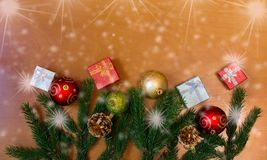 Christmas border made of fir branches and gifts. Stock Photography