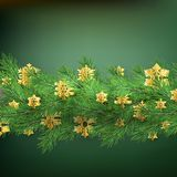 Christmas border made of realistic looking pine branches with gold foil snowflakes on green. EPS 10. Vector file stock illustration