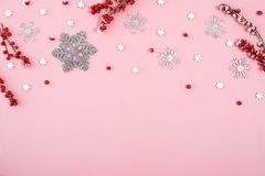 Christmas border made with red icing berries and snowflakes. View from the top royalty free stock photography