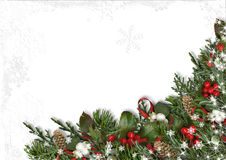 Christmas Border Of Holly, Mistletoe, Cones Over White Background. Stock Photography