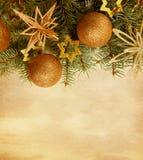 Christmas border on paper background. Beige paper background with Christmas border royalty free stock image