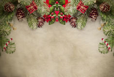 Christmas Border on Parchment. A Christmas border at top of frame consisting of artificial pine tree fronds and decorative ornaments, framing top and sides of stock photos