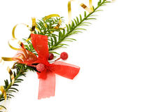 Christmas border with pine branch. Christmas border with pine tree branch and festive red ribbons decorations. Isolated on white background Stock Images