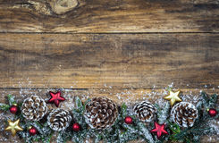 Christmas border with pine cones, stars and balls decoration Royalty Free Stock Image
