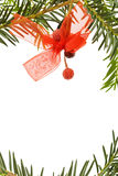 Christmas border with pine tree. Festive Christmas frame with traditional pine tree branch and red ribbons. Isolated on white background Stock Images