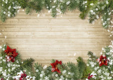 Christmas border with poinsettia onold wood background. Christmas background with beautiful décor of fir branches, holly and poinsettia with place for photos royalty free stock photography