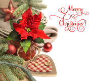 Christmas border with poinsettia and winter decorations, text sp Royalty Free Stock Images