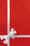 Christmas border red background gift bow ribbon vertical Stock Image