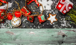 Christmas border with red holiday decorations on rustic wooden background Royalty Free Stock Images
