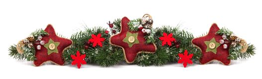 Christmas border with red star ornaments isolated on white Stock Images