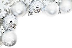 Christmas border of snowflakes and silver baubles Royalty Free Stock Photo