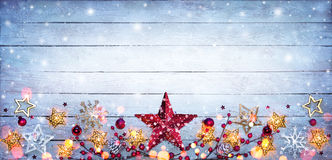 Christmas Border - Stars Decorations. On Snowy Plank royalty free stock photography