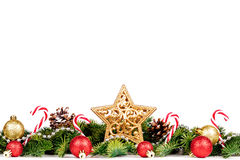Christmas Border - tree branches with golden balls, candy and big star isolated on white. Border - tree branches with golden balls, candy and big star isolated stock photo
