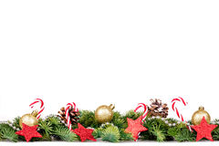 Christmas Border - Tree Branches With Golden Balls, Candy And Decoration Royalty Free Stock Photo