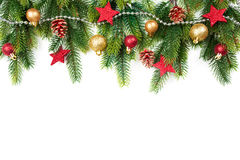 Christmas border with trees, balls, stars and other ornaments, isolated on white Stock Image