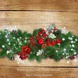 Christmas border on a vintage wooden board with space for text o Royalty Free Stock Image