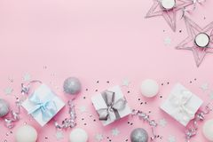 Free Christmas Border With Gift Boxes, Balls, Decoration And Sequins On Pink Table Top View. Flat Lay. Copy Space For Greeting Card. Royalty Free Stock Photo - 102797815