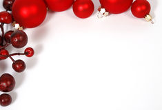 Christmas bordering. From red berries and baubles isolated on white background Stock Photography