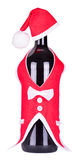 Christmas bottle of wine in a suit of Santa Claus Stock Photo
