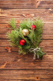 Christmas bouquet of fir tree branch with christmas balls on woo. Green christmas bouquet of fir tree branch Stock Photo