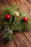 Christmas bouquet of fir tree branch with christmas balls on woo. Green christmas bouquet of fir tree branch Stock Photos