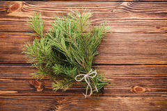 Christmas bouquet of fir tree branch on wooden background. Green christmas bouquet of fir tree branch Royalty Free Stock Photography