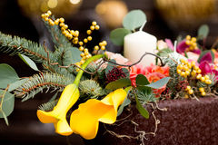 Christmas bouquet of flowers. Yellow callas bouquet in the New Year with candles Royalty Free Stock Images