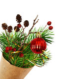 Christmas bouquet with pine twigs, cones, berries and red ball i Royalty Free Stock Photo