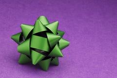 Christmas bow. On  Orange background Royalty Free Stock Images