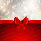 Christmas bow background. Decorative Christmas background with a glossy red bow and snowflakes design Royalty Free Stock Image
