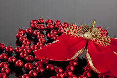 Christmas bow and beeds. Top angle Royalty Free Stock Images