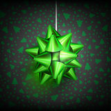 Christmas bow glossy-04. Green Christmas Bow on dark and green background. Christmas related ornaments objects on color background. Greeting Card Ready for your Stock Images