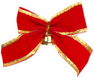 Christmas bow with a golden bell Stock Image