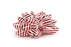 Christmas bow in red and white. This is a christmas or birthday bow to go on top of a present or gift. The actual ribbon has tiny dimples, and is not a smooth royalty free stock images