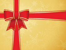 Christmas bow and ribbons with gold background Stock Photos