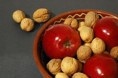 Christmas bowl. Apples and nuts in a bowl Royalty Free Stock Images