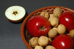 Christmas bowl. Apples and nuts in a bowl with cutted apple showing a star Stock Photography