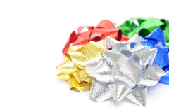 Christmas Bows. Colorful metallic christmas bows on a white background Royalty Free Stock Images