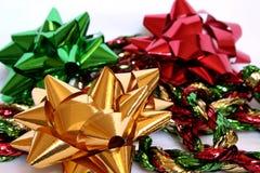 Christmas Bows. And garland Stock Photos