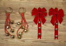 Christmas Bows and Bells on Aged Wood Stock Images