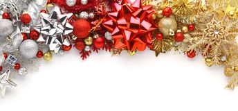 Christmas bows, ornaments, and decorations on white. Background Royalty Free Stock Image