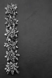 Christmas Bows. Pewter/silver Christmas bows on a slate background Royalty Free Stock Photography